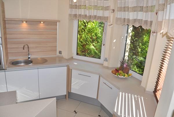 Metamorfoza kuchni po11 latach - wymiana frontów szafek - zdjęcie PO- Kuchnie Pinio projektowanie kuchni